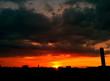 canvas print picture - Sonnenuntergang mit Wolken und Skyline