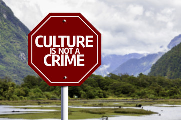 Culture is not Crime red sign with a landscape background