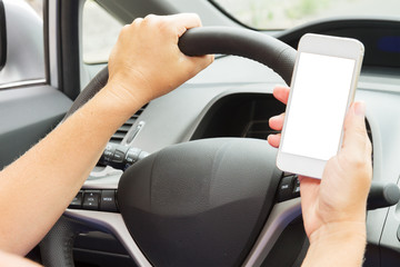 hands driving and  holding a phone with empty  screen