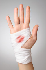 Hand with bloody bandage