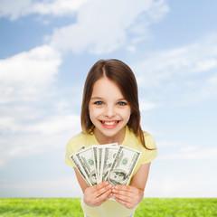 smiling little girl with dollar cash money