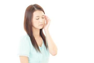 頭痛を訴える女性