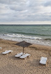 Sun umbrella on empty beach