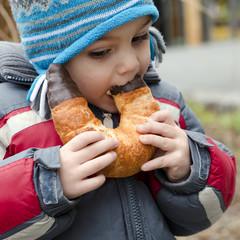 Child eating on street
