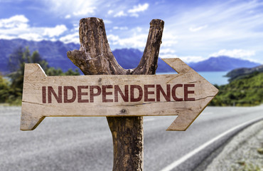 Independence wooden sign with a street background