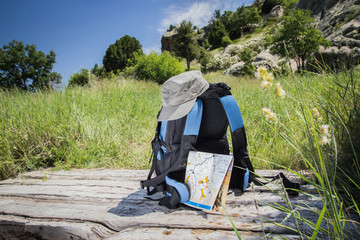 Hiking with bag and accessories for adventure.