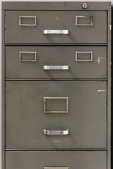 Drawers of an old metal filing cabinet