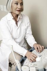 Expert female doctor programming medical machine