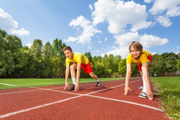 Two boys in ready position to run marathon
