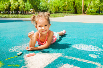 Little girl play with chalk