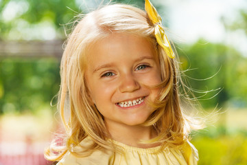 Close portrait of smiling happy blond little girl