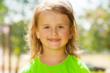 Smiling little girl portrait in the park