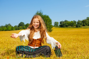 Laughing girl in costume of pirate sitting