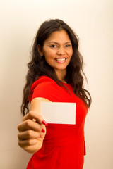woman dressed casual offering business card.