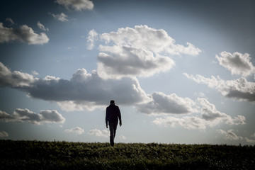 lonely man walking in an empty landscape