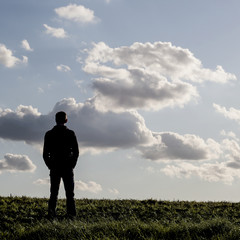 young lonely  man still in the countryside
