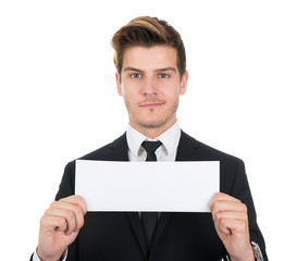Portrait Of Confident Businessman Holding Blank Sign