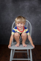Child sitting on chair in School, Education