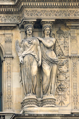 Pair of statues on Louvre building