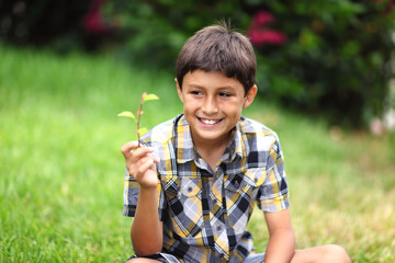 Young boy with flower
