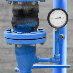 White manometer on blue pipe
