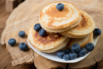 Fritters with fresh blueberries, close-up, horizontal shot