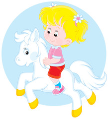 Girl riding a white pony