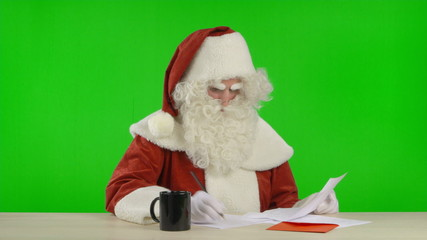Santa Claus is Reading a Wish List and Makes Notes