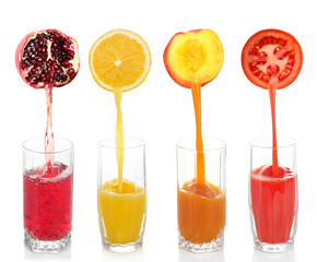 Juice pouring from fruits and vegetables into glass, isolated