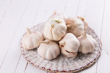 Garlic on wooden background.