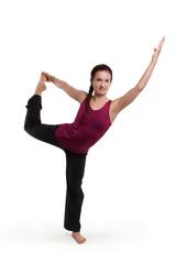 junge schöne Frau in einer Yogapose