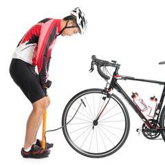 Asian cyclist using air-pump