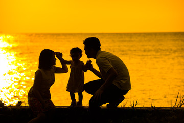 Asian family outdoor sunset beach