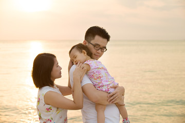Asian family vacation at beach
