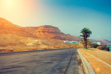 The road at sunrise in Ein Bokek city, Israel.