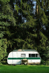 An outmoded travel trailer in the Belgian Ardennes