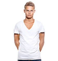 Handsome teen guy in white t-shirt isolated on white