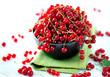 Redcurrant. Ripe organic redcurrant berries over white