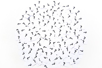 A background of question mark signs and symbols