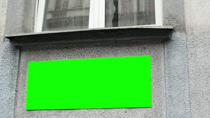 sign on the building with window - green screen