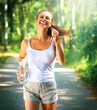 Running woman outdoor in a park