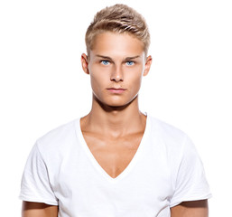 Handsome guy in white t-shirt isolated on a white