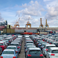 Cargo sea port. Sea cargo cranes. Cars.