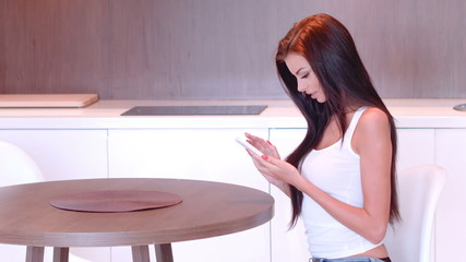 Brunette Texting on Her Mobile Phone