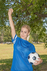 female holding a soccer ball