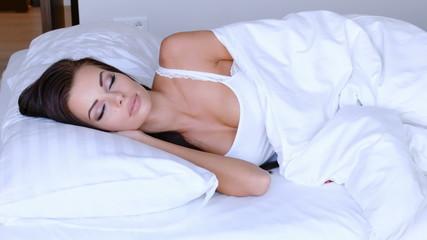 Beautiful Woman Enjoying A Restful Nights Sleep Lying In Bed