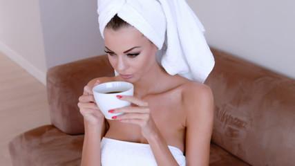 Beautiful Young Woman Enjoying A Cup Of Coffee