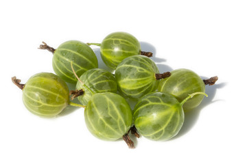 Some Gooseberries on a White Background with Water Drops