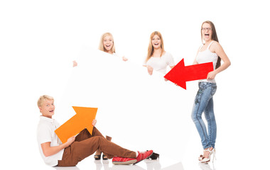 Teenagers with a blank, white billboard isolated on white