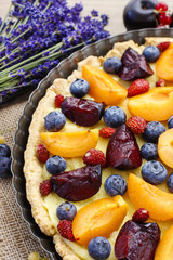 Sweet tart with peaches, plums and blueberries